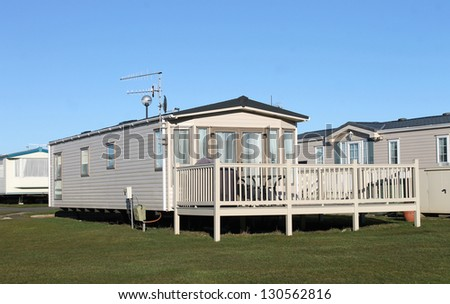 Modern static caravans in park with blue sky background. - stock photo