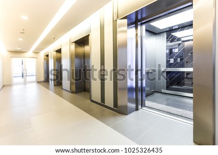 Modern Steel Elevator Cabins In A Business Lobby Or Hotel, Store, Interior,  Office