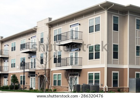 Modern 3 story apartment or condominium building in a suburban location. - stock photo
