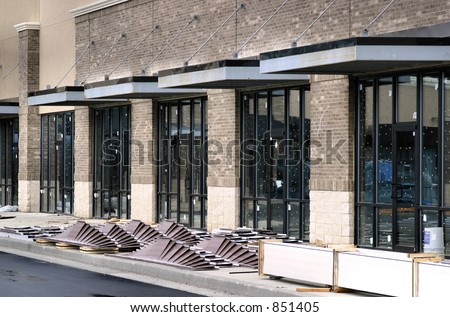 Modern Strip Center Construction Storefronts - stock photo