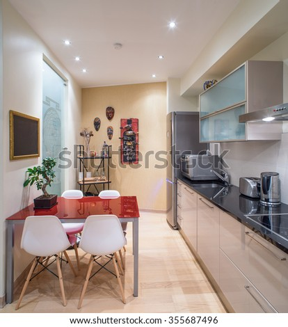 Modern studio interior in private house. Kitchen