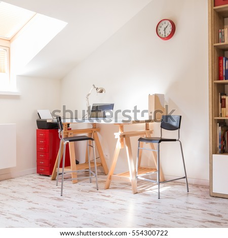 Modern study in scandynavian style with a desk and a bookshelf