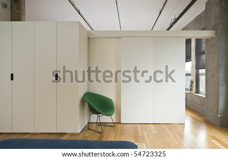 Modern style bedroom interior with room divider separating it from the rest of the loft. Horizontal shot. - stock photo