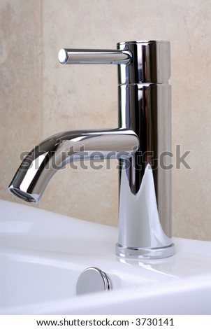Modern Style Chrome Single Lever Bathroom Faucet Tap - stock photo