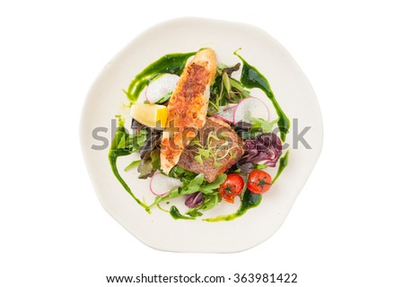 Modern style clean food, grilled salmon with toast and salad dressed with green sauce isolated on white background with clipping path - stock photo