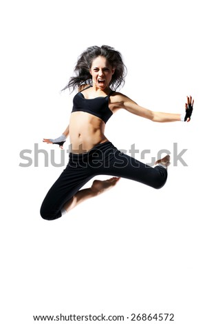 modern style dancer jumping behind studio background - stock photo
