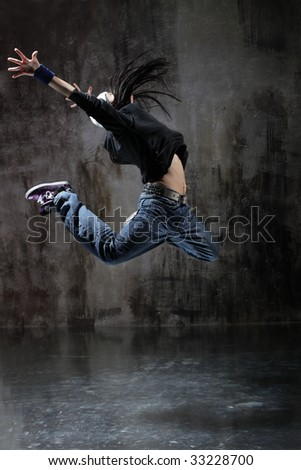 modern style dancer jumping on dirty grunge background