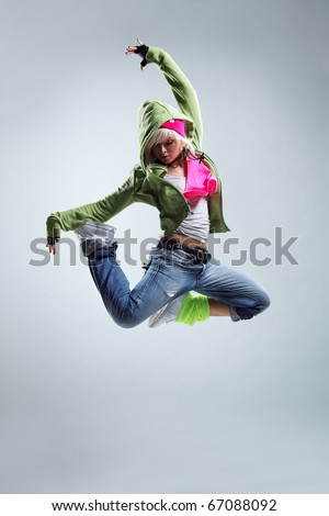 modern style dancer jumping on studio background - stock photo