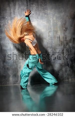 modern style dancer posing behind studio background - stock photo