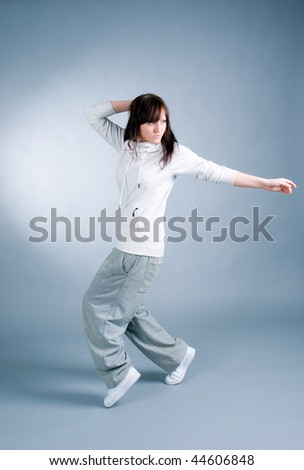 modern style dancer posing on  gray background