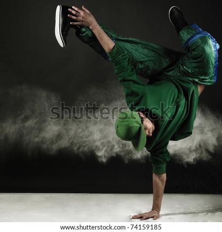 modern style dancer posing on grunge grey background - stock photo