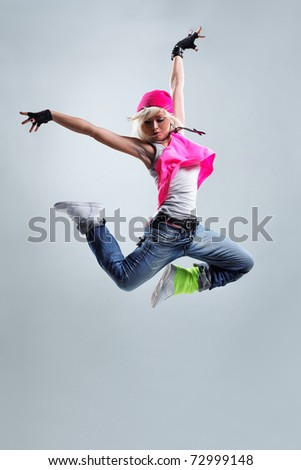 modern style dancer posing on studio background - stock photo