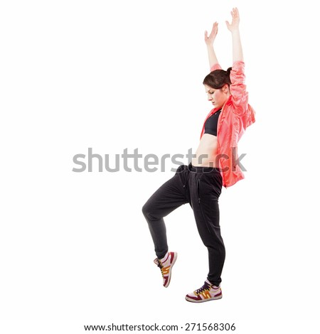 modern style dancer posing with hands up in studio background - stock photo