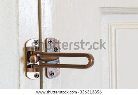 modern style door handle on wooden door. - stock photo