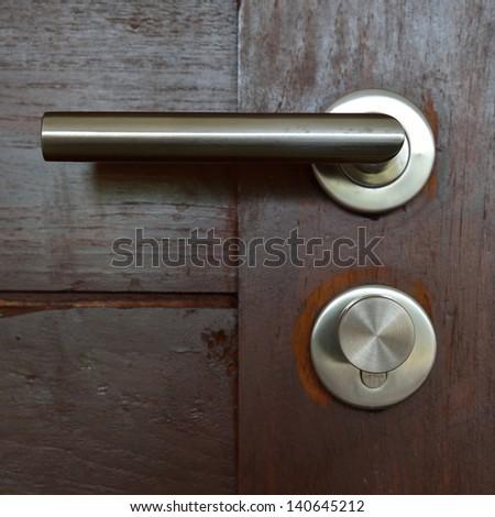 Modern style door handle ,open the door - stock photo