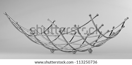modern style fruit basket made of steel wire - stock photo