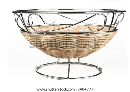 modern style fruit basket made of steel wire and rattan decoration - stock photo