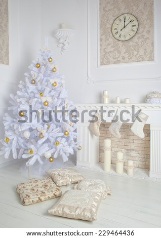modern style interior of fireplace with christmas tree and presents in white - stock photo