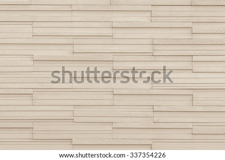 Modern style marble tile wall rough textured detailed patterned backdrop for interior decoration: Marble tiled wall linear pattern texture background in light aged sepia beige brown color tone - stock photo