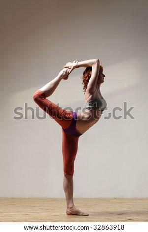 modern style yoga female posing on studio background - stock photo