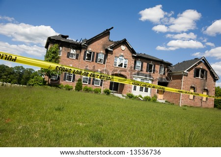 Modern suburban house completely burned out, destroyed by fire - stock photo