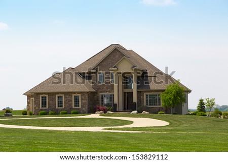 modern suburban stone detached house - stock photo