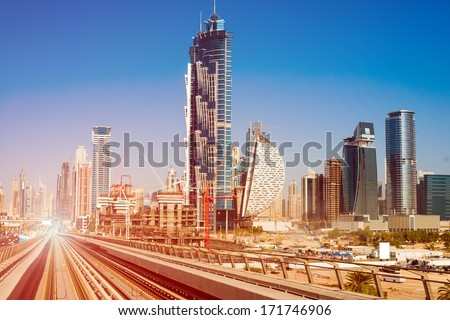 modern subway line on the urban landscape in Dubai - stock photo
