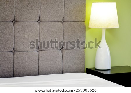 Modern table lamp in the bedroom - stock photo