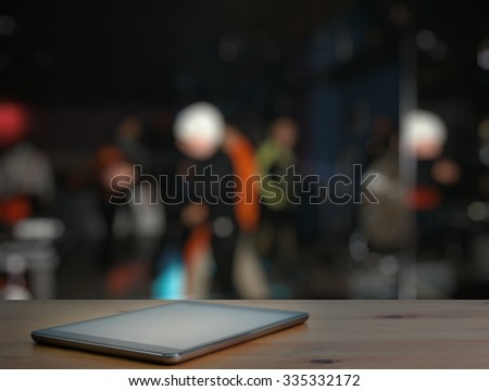 modern tablet, bar in a night club - stock photo