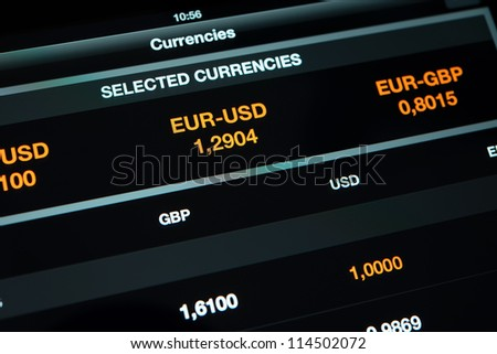 Modern tablet pc on a table with currency exchange information - stock photo