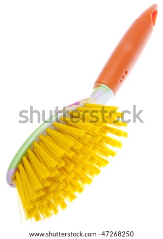 Modern take on spring cleaning with this bright orange and yellow cleaning brush.