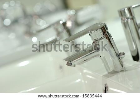 Modern tap in showroom - stock photo
