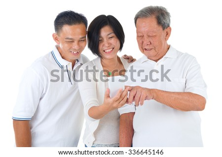 Modern technology, age and people concept. Asian senior man with his daughter and son taking selfie, using smartphone, self photographing.  - stock photo