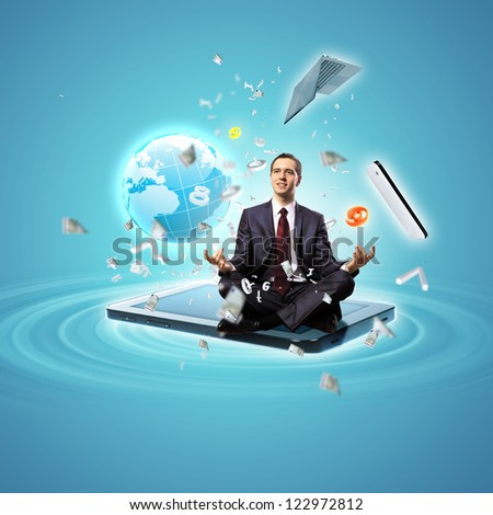 Modern technology illustration with computers and business person - stock photo