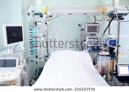 Modern technology in intensive care unit room  - stock photo