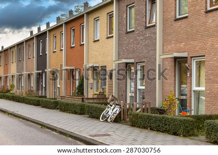 Modern Terra Colored Middle Class Terraced Houses in the Netherlands, Europe - stock photo