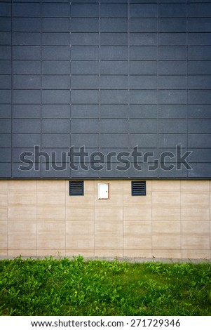 Modern tile wall and old sidewalk - stock photo