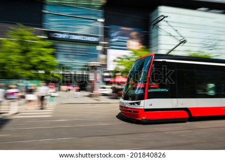 Modern tram blurred in motion in the Prague city, Europe
