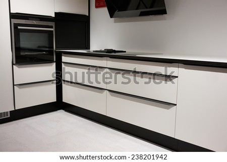 Modern trendy design wooden black and white kitchen                                - stock photo