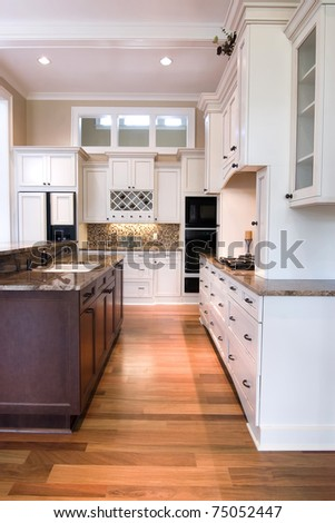 modern, trendy kitchen with mix of woods - stock photo