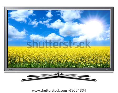 Modern TV lcd, led with rapeseed field and blue sky on screen. - stock photo