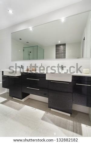 Modern twin bathroom in stylish Australian apartment - stock photo