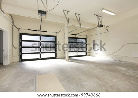 Modern two cars garage with glass doors. - stock photo