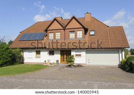 Modern two family house with solar cells and garage.