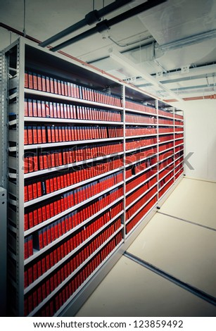modern underground archive with video materials - stock photo