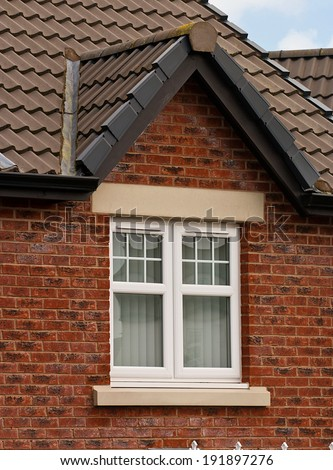 Modern UPVC Double Glazed Apex Window Unit - stock photo