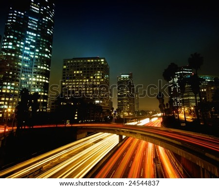Modern Urban City at Night with Freeway Traffic, Los Angeles - stock photo