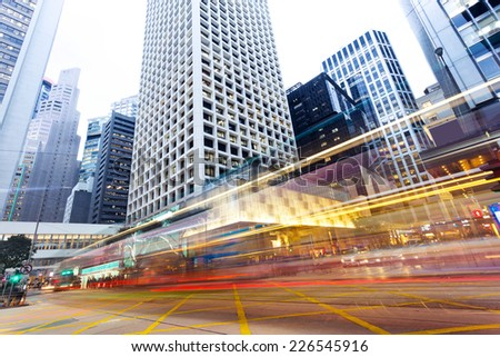 modern urban city traffic trails with cityscape background.timelapse. - stock photo