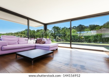 Modern villa, interior, wide living room with divan - stock photo