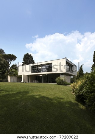 modern villa surrounded by nature, outdoors - stock photo